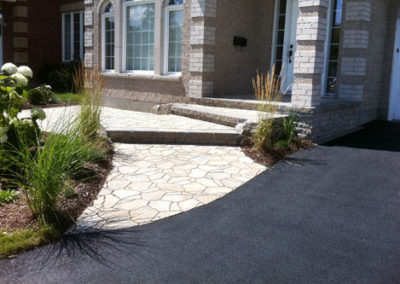 Asphalt driveway with interlock steps