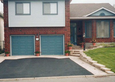 Asphalt driveway with interlock stone borders