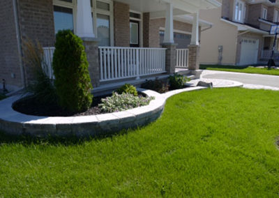 Curved flower beds that matches your entryway