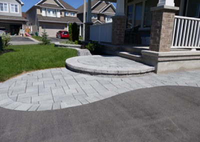 Curved stone driveway details and steps