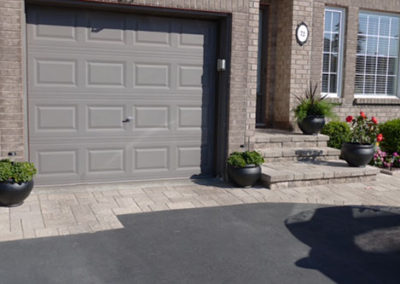 Stone border along driveway and entryway