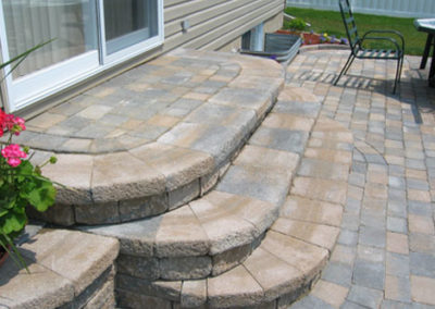 Interlocking curved brick steps and flower bed