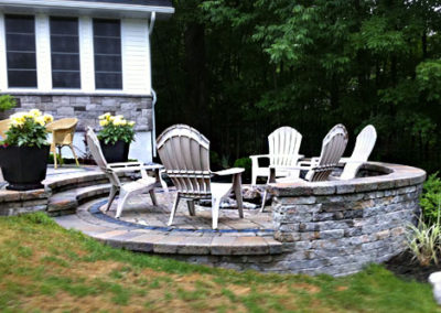 Natural stone deck with steps and retaining wall