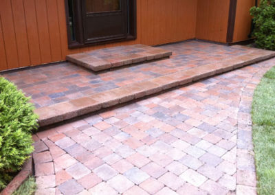 Stone walkways bring warmth to your entrance