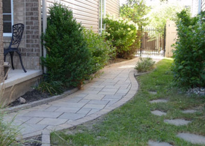Curved side walkway with stone