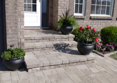 Enhanced stone interlock entryway